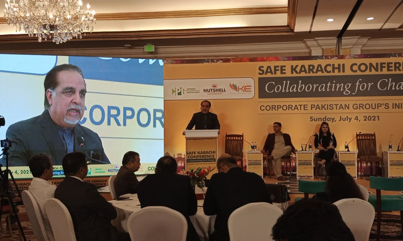 Sindh Governor Imran Ismail speaks at the Safe Karachi conference. — Photo by writer