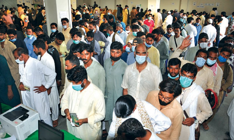 Hundreds of people aspiring to go abroad queued up at Expo Centre for coronavirus vaccination on Monday.
