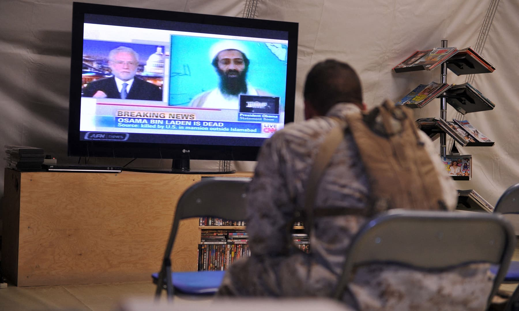 In this file photo taken on May 2, 2011, US Marines of Regiment Combat Team 1 watch TV announcing the death of Osama bin Laden, at Camp Dwyer in Helmand province. — AFP