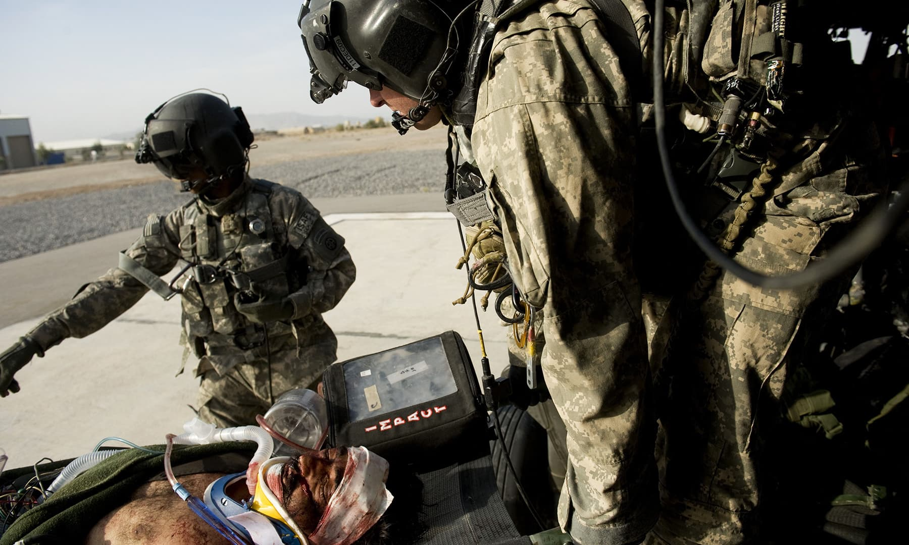 In this file photo taken on November 4, 2009, US medics of Medevac unit of 3rd battalion 82nd Combat Aviation Brigade carry an injured Afghan soldier off the helicopter to be taken to the hospital in Kandahar. — AFP
