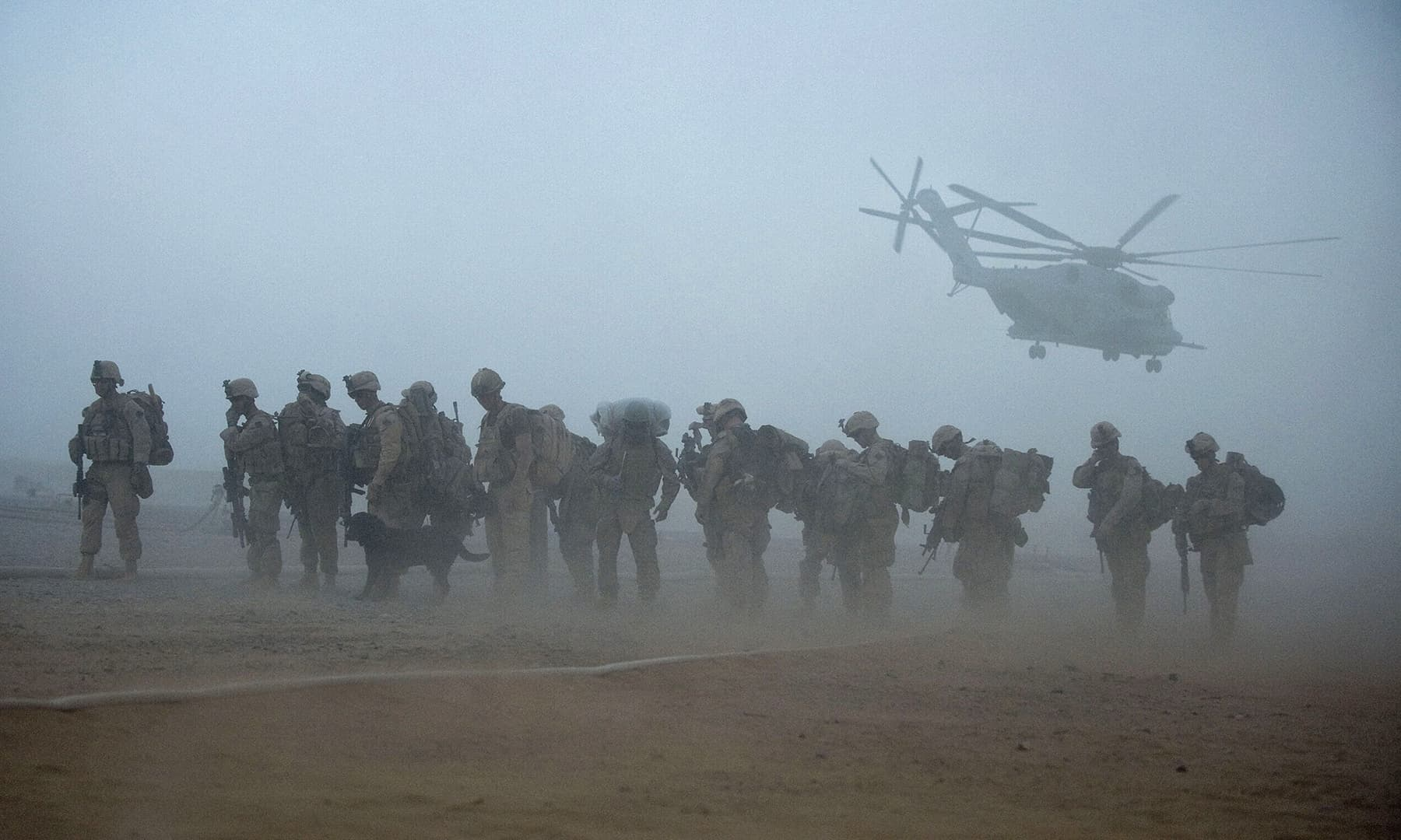 In this file photo taken on July 2, 2009, US Marines from the 2nd Battalion, 8th Marine Regiment of the 2nd Marine Expeditionary Brigade wait for helicopter transport as part of Operation Khanjar at Camp Dwyer in Helmand province in Afghanistan. — AFP