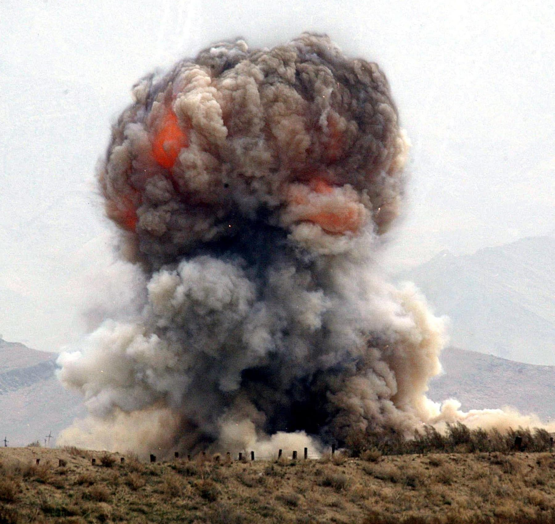 In this file photo taken on March 20, 2002, a fireball emerges from explosion of ordnance in Bagram. — AFP