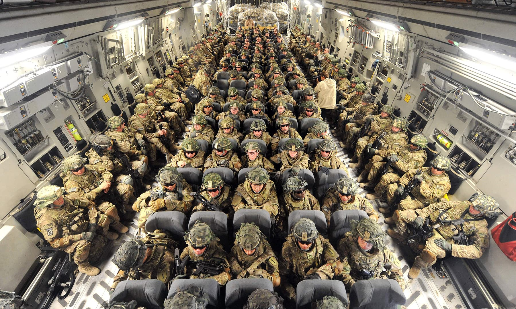 In this file photo taken on April 15, 2011, US soldiers from the 234th Infantry Division, Fort Riley, Kansas are seen inside of a plane to Afghanistan from the US transit center Manas, 30km from Bishkek. — AFP