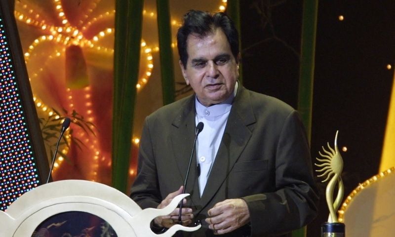 In this file photo taken on May 22, 2004, Indian veteran actor Dilip Kumar speaks at the podium for his award for oustanding achievement in Indian cinema at the 5th International Indian Film Academy (IIFA) Awards in Singapore. — AFP