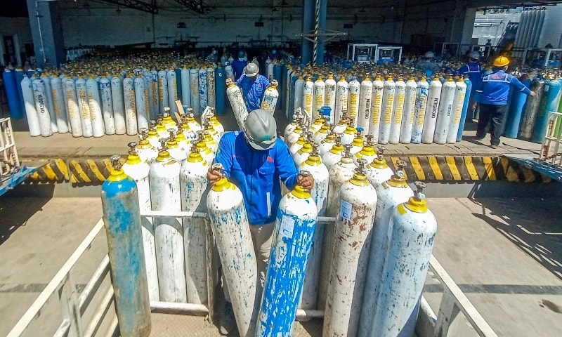 Workers for an oxygen supplies company prepare cylinders for distribution in Semarang, Central Java on July 6. — AFP