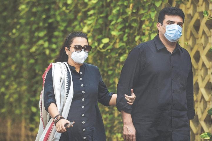 Actress Vidya Balan and her husband arrrive at the residence.—AFP