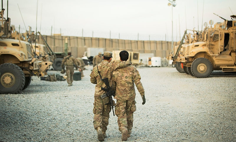 In this file photo, a United States soldier from the 3rd Cavalry Regiment walks with the unit's Afghan interpreter before a mission. — Reuters