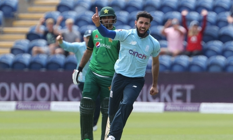 England's Saqib Mahmood celebrates taking the wicket of Pakistan captain Babar Azam for a duck during the first one-day international cricket match between England and Pakistan at Sophia Gardens stadium in Cardiff, Wales, UK, July 8. — AFP