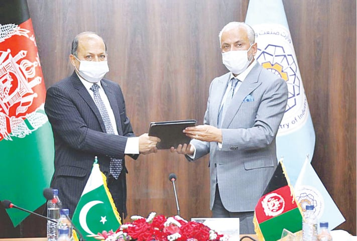 KABUL: Ambassador to Afghanistan Mansoor Ahmad Khan is handing over a copy of Protocol-VI of APTTA 2010 to Afghan Commerce Minister Nisar Ahmed Faizi Ghoryani on Thursday.—APP
