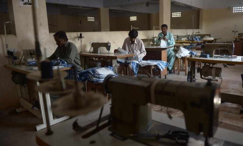 Garment workers making shirts at a factory in Karachi, Pakistan, February 2015. — AFP