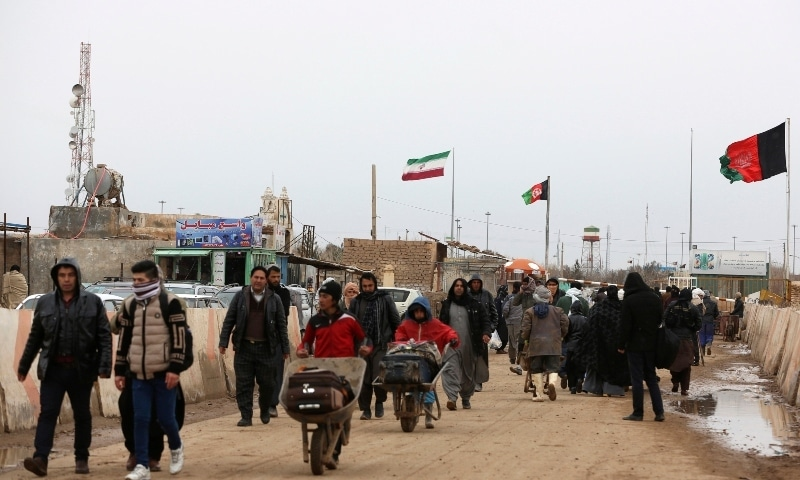 In this file photo, Afghans return to Afghanistan at the Islam Qala border with Iran, in the western Herat Province. — AP