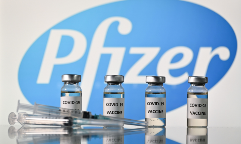 This file illustration photo taken on November 17 shows vials with Covid-19 Vaccine stickers attached and syringes with the logo of US pharmaceutical company Pfizer. — AFP