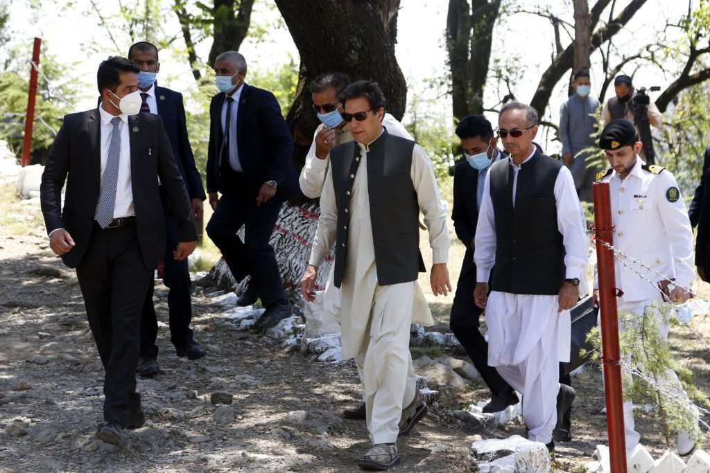 Imran Khan, prime minister of Pakistan, (centre) returning from planting a tree as part of the 10 Billion Tree Tsunami programme in May 2021 (Image: Xinhua / Alamy)