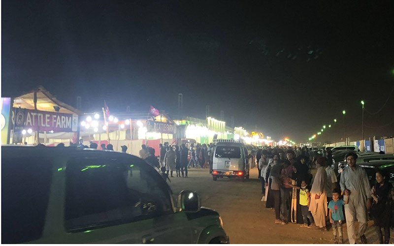 A view of the main street that leads into the cattle market. Over 250,000 people visit the market on any given day, with the number rising to over 400,000 on weekends. There is minimal enforcement of Covid-19 SOPs. — Photo: Shahzeb Ahmed