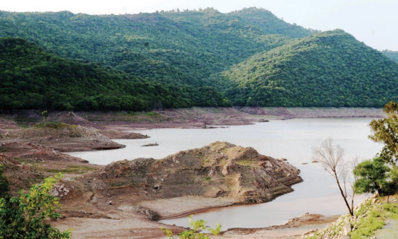 Water level in Simly Dam has decreased due to low rains in the catchment areas. However, officials say water in the dam is sufficient to meet the needs of residents for one month. — Photo by Mohammad Asim