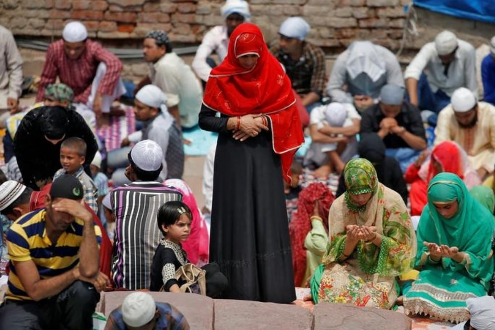 Muslims offer prayers during the last Friday of Ramazan, outside Jama Masjid in the old quarters of Delhi, June 23, 2017. — Reuters