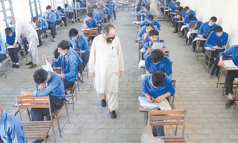 PESHAWAR: Students busy solving their matriculation paper at an examination centre here on Saturday. The opposition on Friday staged a walkout from the National Assembly after federal Minister for Education and Professional Training Shafqat Mehmood rejected their demand for delaying the matriculation and intermediate examinations in the country. — PPI