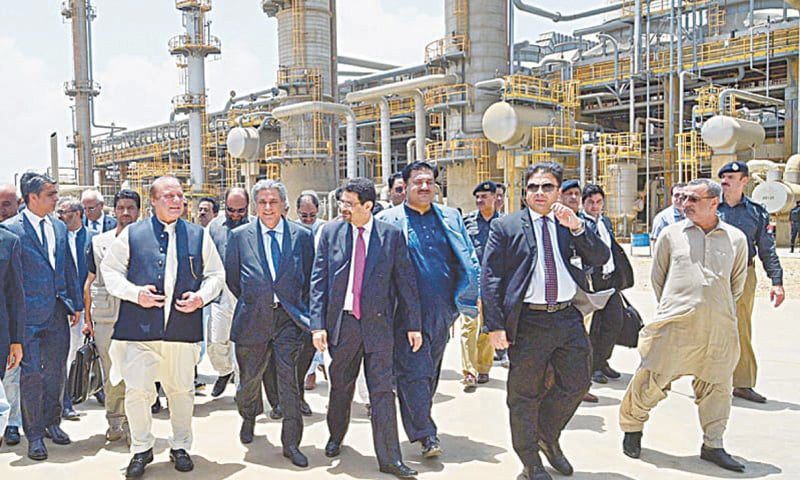 In this file photo, Arif Naqvi is seen with Prime Minister Nawaz Sharif at an oil refinery | APP