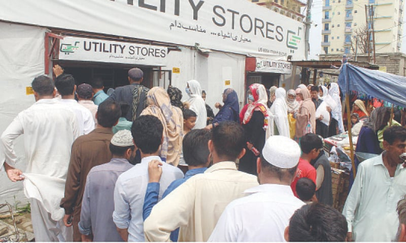 RAWALPINDI: People wait in queues to purchase sugar from an outlet of the Utility Stores at a weekly bazaar in the Committee Chowk area on Sunday.—Online