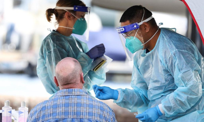 In this file photo, medical personnel holds a swab while administering a test for the coronavirus at a pop-up testing centre as the state of New South Wales grapples with an outbreak of new cases in Sydney, Australia. — Reuters/File