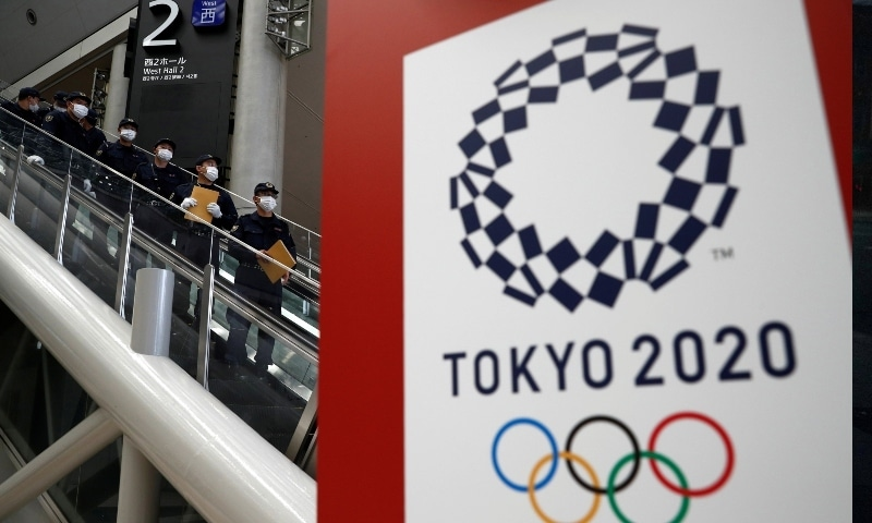 Police officers conduct a security sweep of the Tokyo Olympic Main Press Center in Tokyo on July 12. — Reuters