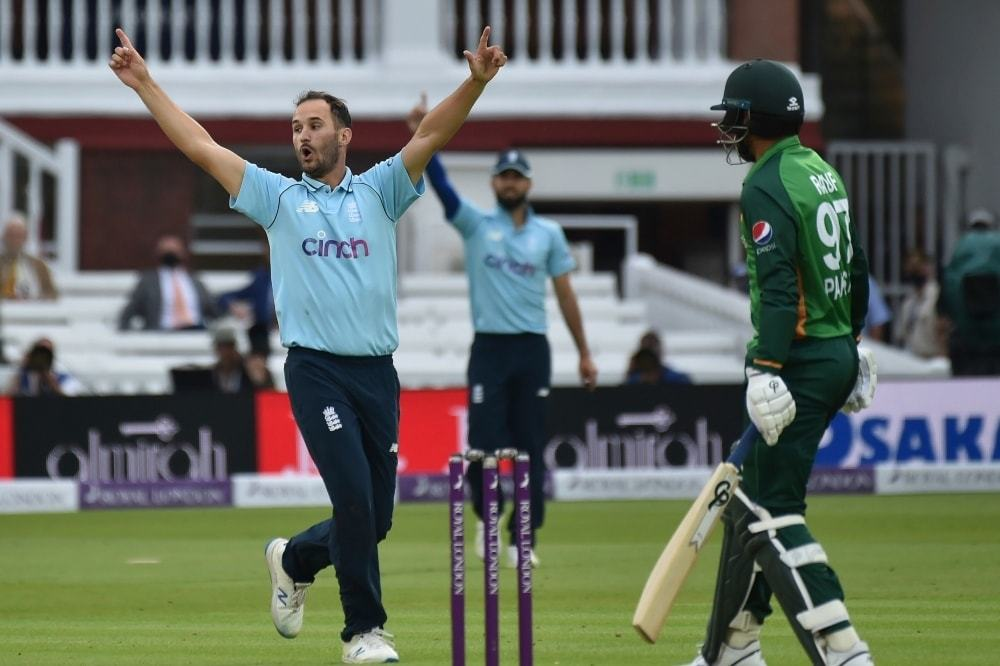 England's Lewis Gregory, left, celebrates the dismissal of Haris Rauf, right in the second one-day international at Lord's on July 10. — AP