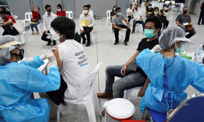 People receive China's Sinovac coronavirus vaccine at the Central Vaccination Centre, inside the Bang Sue Grand Station, in Bangkok, Thailand. — Reuters/File