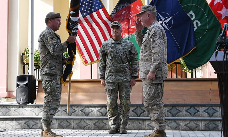 US Army Gen Scott Miller, left, hands over his command to Marine Gen Frank McKenzie, the head of US Central Command, right, at a ceremony at Resolute Support headquarters, in Kabul, Afghanistan, Monday, July 12. — AP