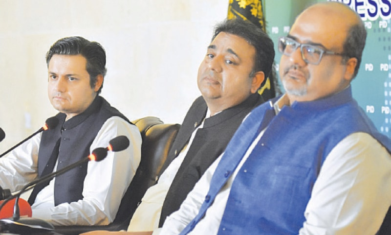 ISLAMABAD: Federal ministers Fawad Chaudhry and Hammad Azhar and Adviser to the PM on Interior Mirza Shahzad Akbar pictured during a press conference on Monday.—White Star