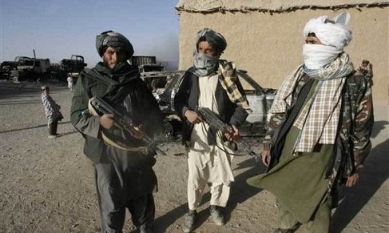 The image shows Afghan Taliban fighters. — AFP/File