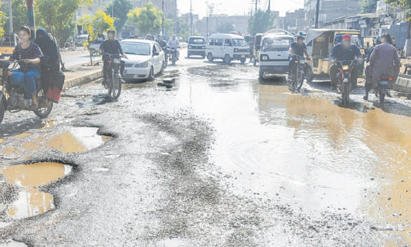 While the Sindh government claims all was well after Monday's rainfall, the state of the main road in Old Golimar on Tuesday, which was paved recently, tells another tale.—Fahim Siddiqi/White Star