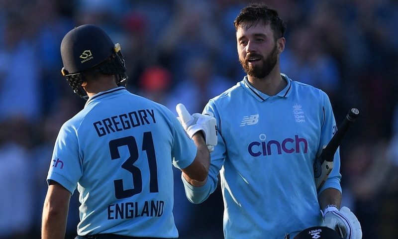 England's Lewis Gregory (L) congratulates England's James Vince (R) after he scores a century during the third one day international (ODI) cricket match between England and Pakistan at Edgbaston cricket ground in Birmingham. — AFP