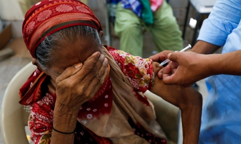 Basanti, 71, reacts as she receives a dose of the coronavirus vaccine at a vaccination center in Karachi. — Reuters