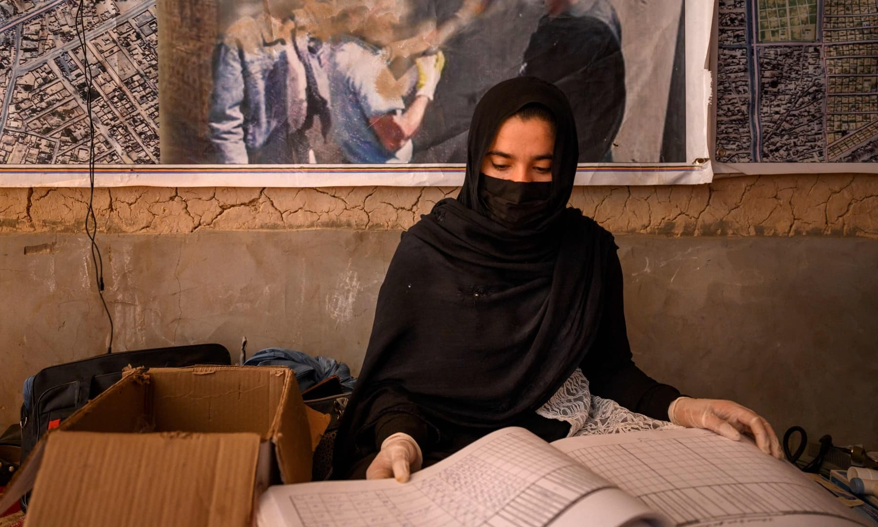 A midwife working for a NGO registers patients at a mobile clinic for women and children set up at the residence of a local elder in Yarmuhamad village, near Lashkar Gah in Helmand province, Afghanistan, March 28, 2021. — AFP/File