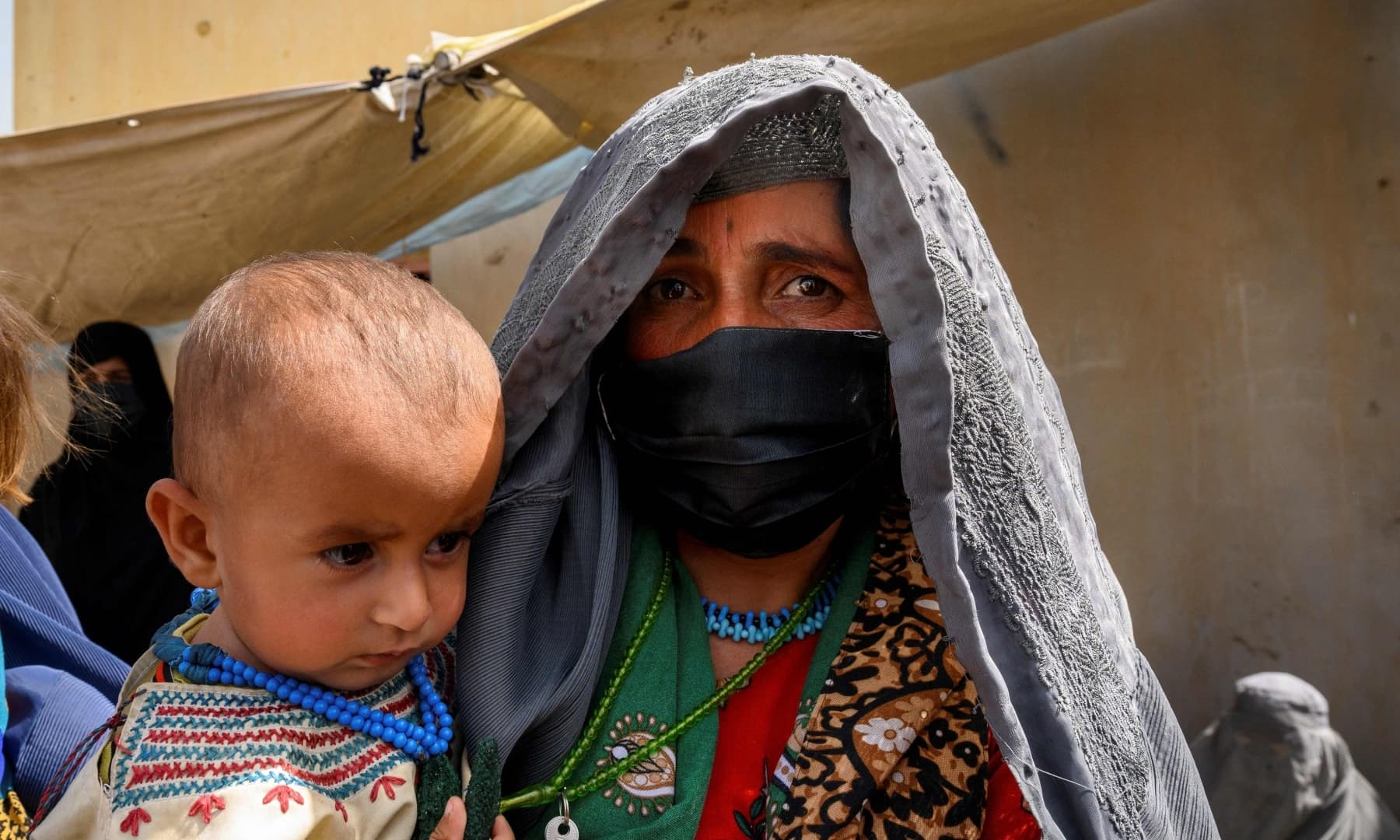 Farzana, who fled her village in Helmand province when it was taken over by the Taliban, waits to see a doctor at a mobile clinic for women and children set up at the residence of a local elder in Yarmuhamad village, near Lashkar Gah in Helmand province, Afghanistan, March 28, 2021. — AFP/File