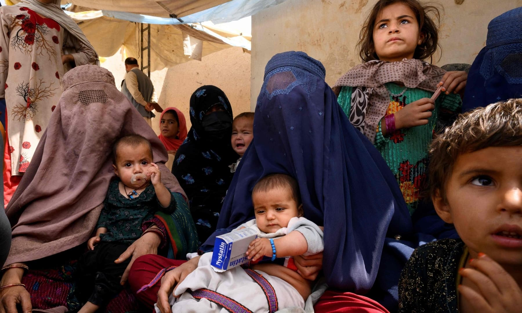 Women wait for their turn at a mobile clinic for women and children set up at the residence of a local elder in Yarmuhamad village, near Lashkar Gah in Helmand province, Afghanistan, March 28, 2021. — AFP/File