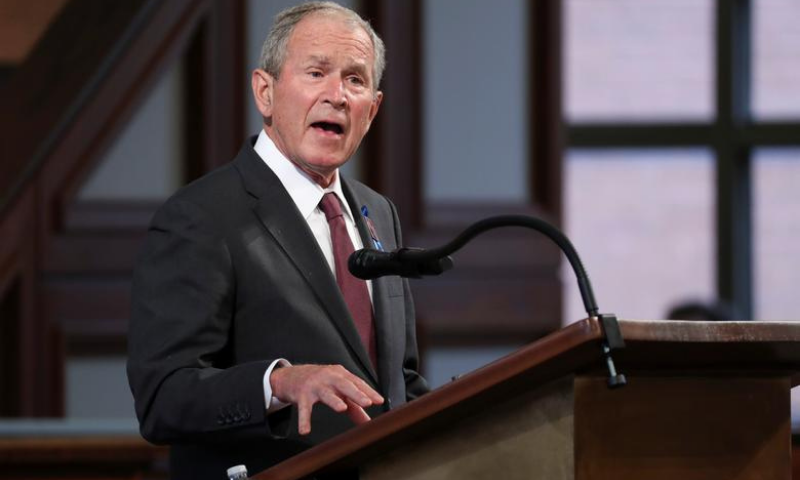 "Former United States president George W. Bush said he believed German Chancellor Angela Merkel ""feels the same way"". — Reuters/File"