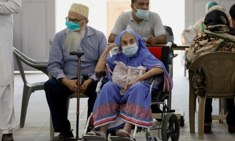 Residents wait for their coronavirus disease vaccine doses, at a vaccination centre in Karachi, April 2. — Reuters/File