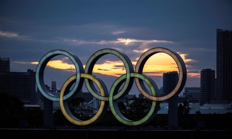 This file photo taken on April 28 shows a general view shows the Olympic rings lit up at dusk on the Odaiba waterfront in Tokyo. — AFP/File