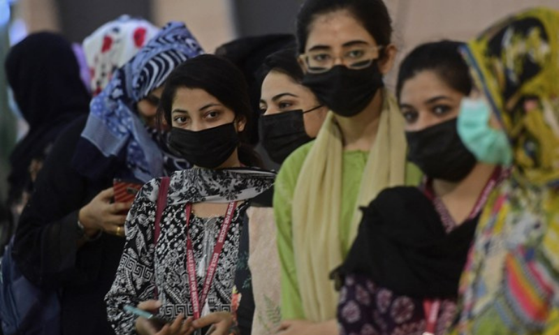 Women wait for their turn to receive a dose of the Sinovac vaccine at Expo Centre in Karachi. — AFP/File