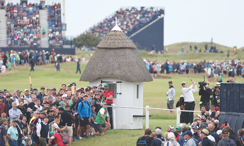SANDWICH: England's Justin Rose plays his shot to the 18th green from the first hole during the first round of the British Open Golf Championship at Royal St George's on Thursday.—AP