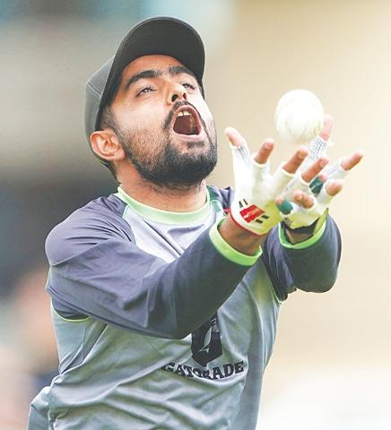 PAKISTAN captain Babar Azam eyes a catch during a training session at Trent Bridge on Thursday.—AP