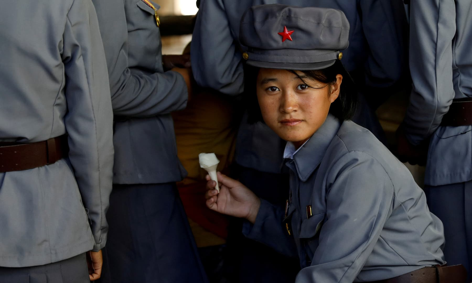 A soldier eats ice cream as she visits a zoo in Pyongyang, North Korea, September 12, 2018. — Reuters/Danish Siddiqui