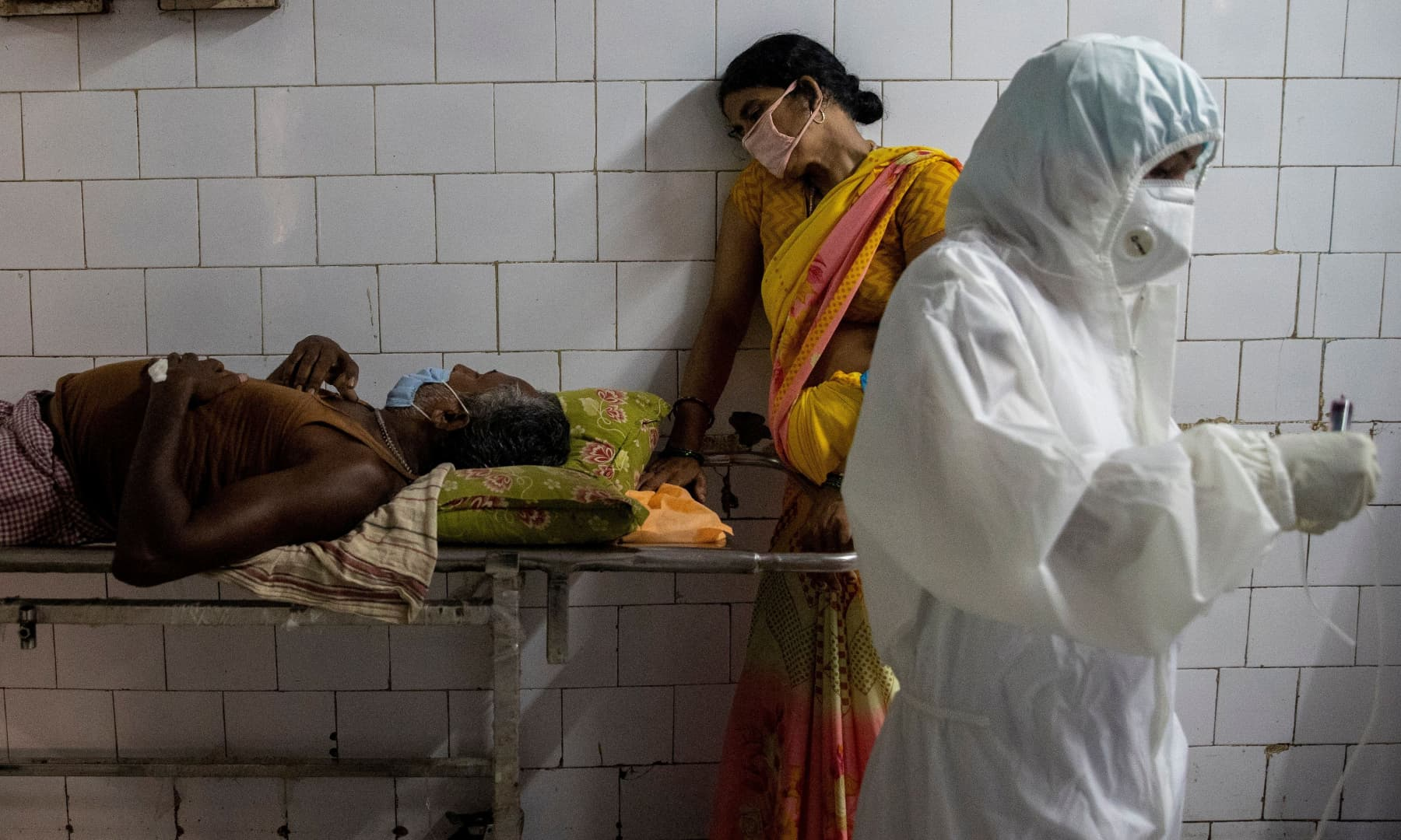 A woman leans against a stretcher holding her husband in the corridor of the emergency ward of Jawahar Lal Nehru Medical College and Hospital, during the coronavirus outbreak in Bhagalpur, in the eastern state of Bihar, India, July 27, 2020. — Reuters/Danish Siddiqui
