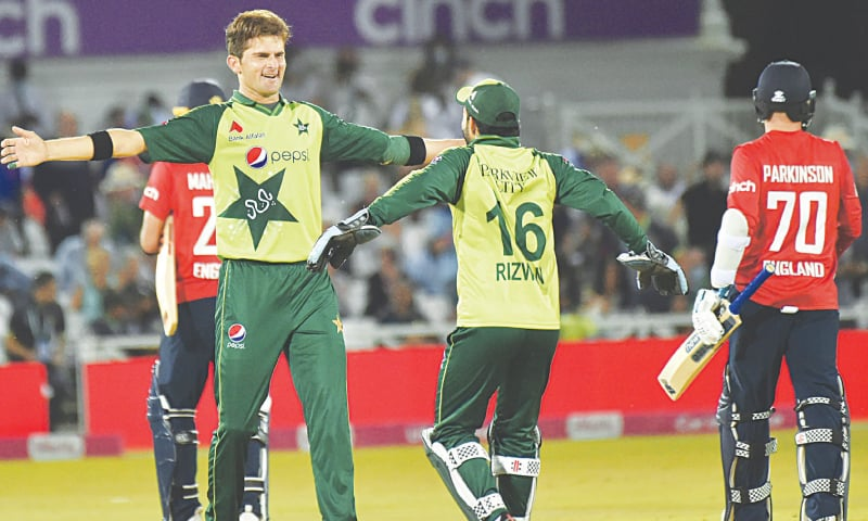 NOTTINGHAM: Pakistan's bowling hero and player-of-the-match Shaheen Shah Afridi (left) celebrates with wicket-keeper Mohammad Rizwan after taking the wicket of Matt Parkinson (right) to end England's innings during the first Twenty20 International at Trent Bridge on Friday. — AP