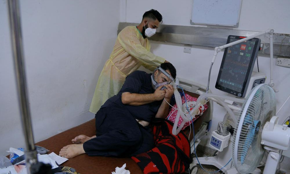 A coronavirus patient receives treatment at a hospital in Najaf, Iraq on Wednesday. — AP