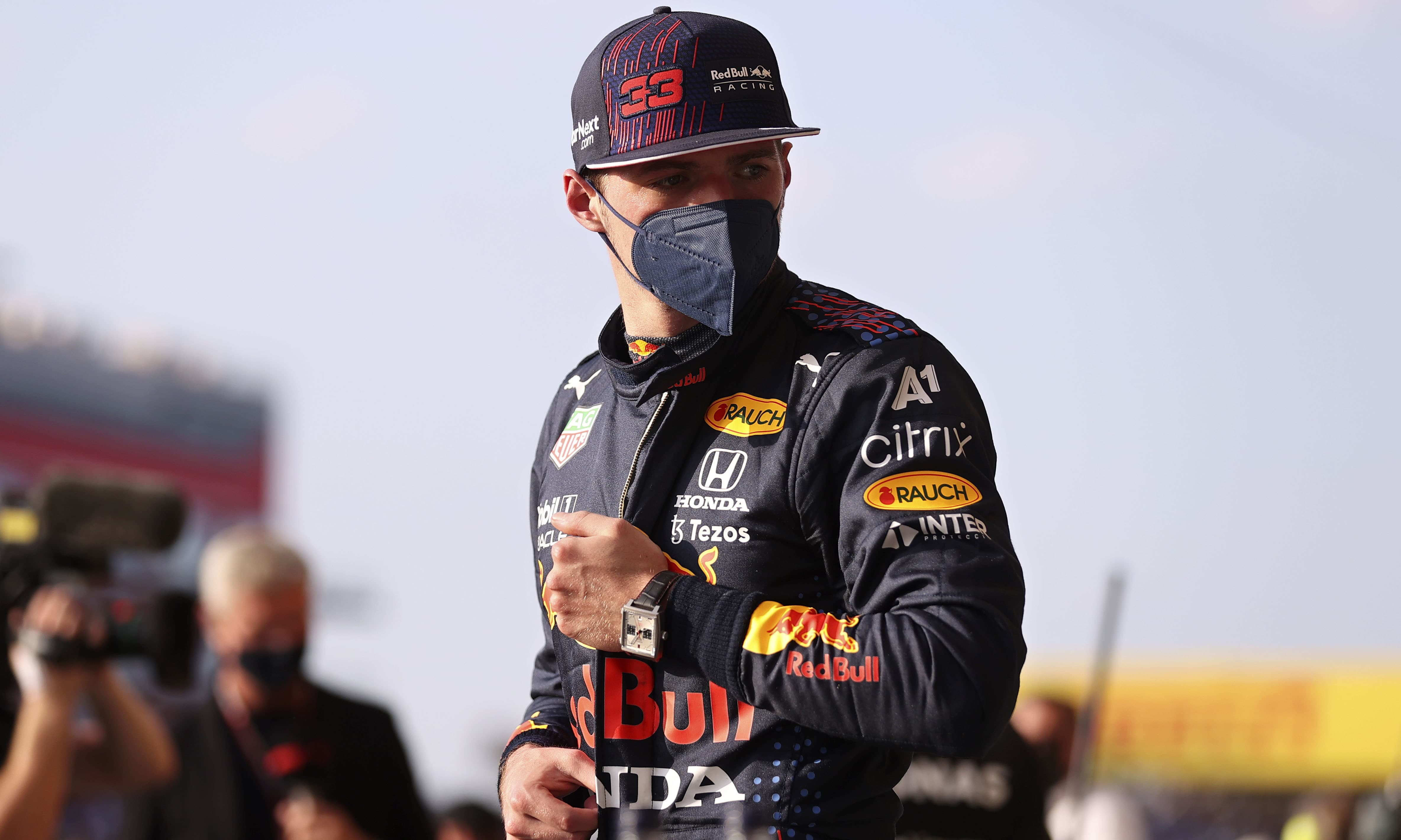 Red Bull driver Max Verstappen of the Netherlands stands in the pit lane at the end of the qualifying session ahead of Sunday's British Formula One Grand Prix, at the Silverstone circuit, in Silverstone, England on Friday. — AP