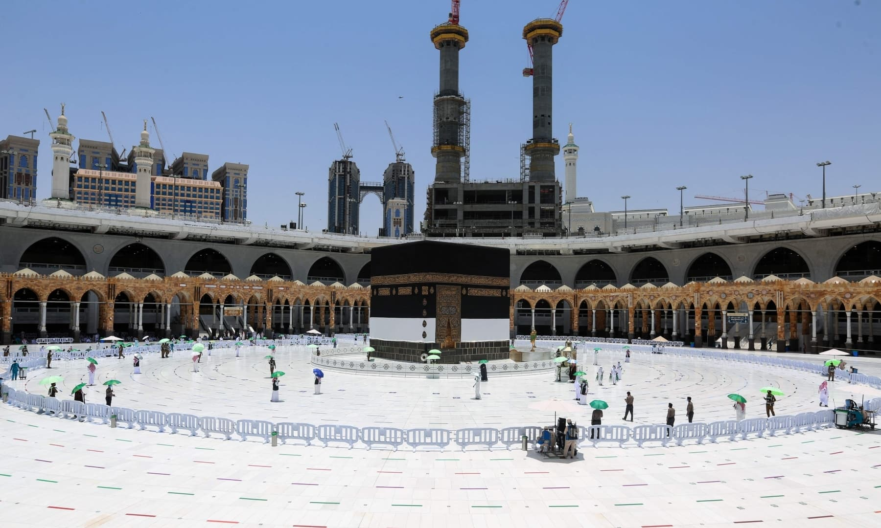 Members of Saudi security forces and staff work around the Kaaba at the Grand Mosque in the holy city of Makkah, Saudi Arabia, July 16, 2021. — AFP