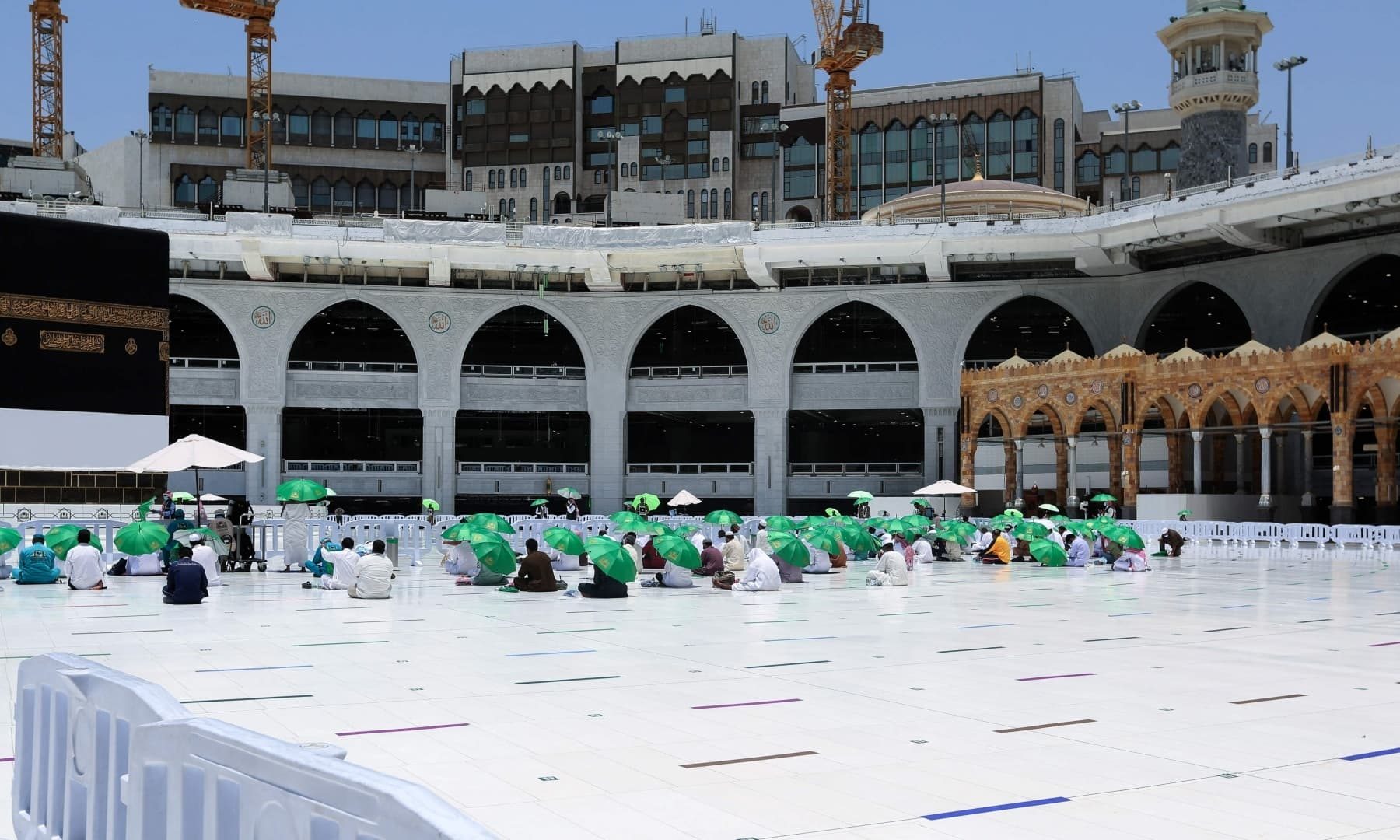 Members of Saudi security forces and staff perform the Friday prayer by the Kaaba at the Grand Mosque in the holy city of Makkah, Saudi Arabia, July 16, 2021. — AFP