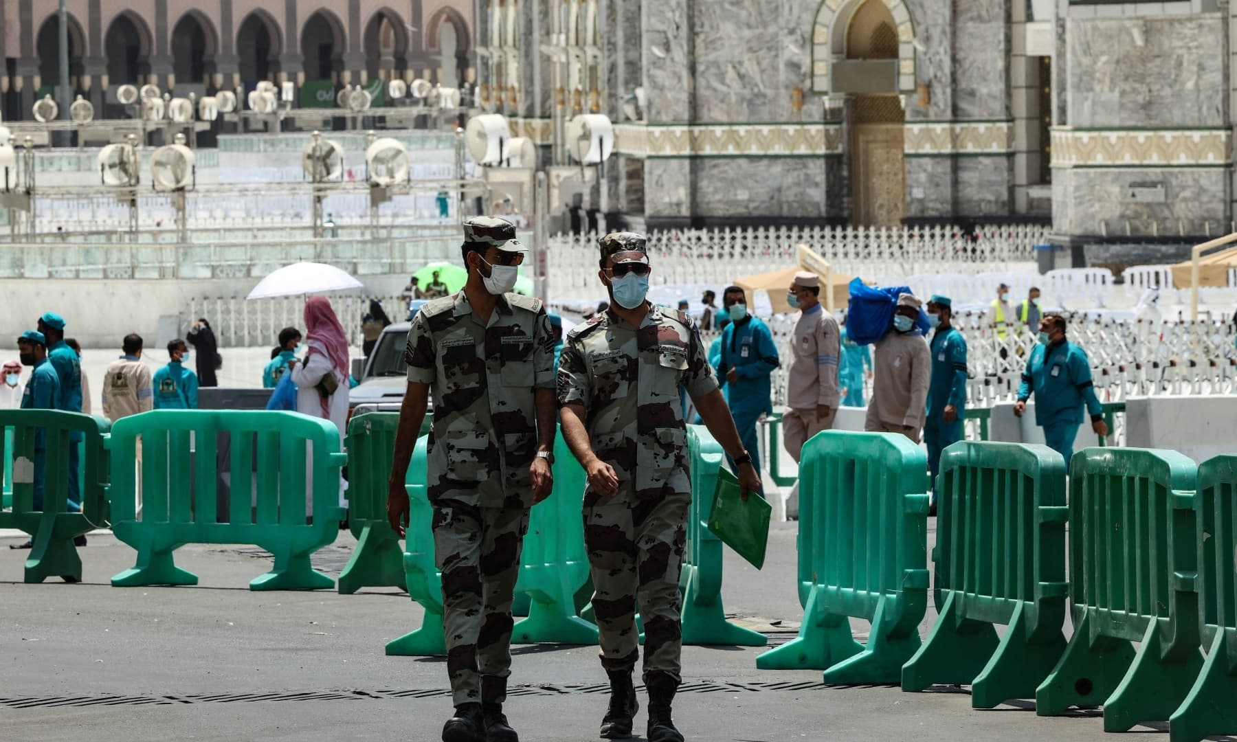 Mask-clad members of the Saudi security forces walk in the holy city of Makkah, Saudi Arabia, July 16, 2021. — AFP